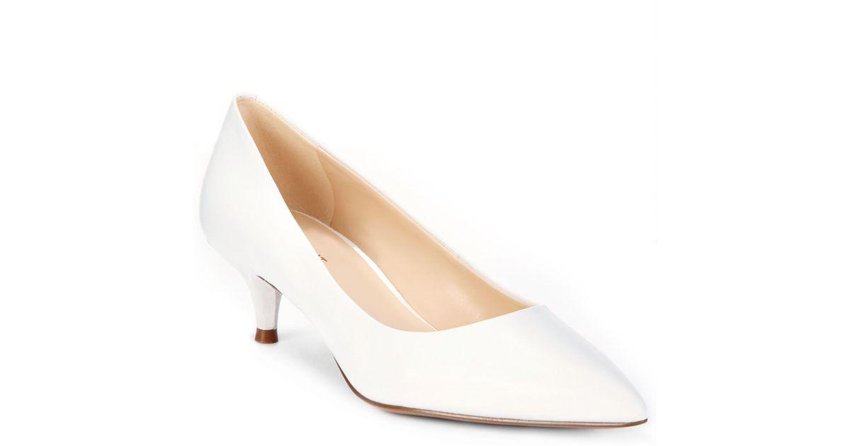 Rüyada Parlak Beyaz Uzun Topuklu Deri Ayakkabı Mağazada Görmek